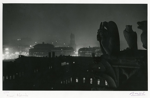 """Lot 125BRASSAÏ (Gyula Halász, dit) (1899-1984)""""N° 313. Paris - vue de Notre Dame, 1934""""Silver gelatin print from 1976 on cartoline paper, signed numbered and dedicated in ink on the margin. Signed, author's stamp and written annotation by the author on the back19,7 x 32,9 cm (29 x 39,5 cm)3000/4 000 €"""