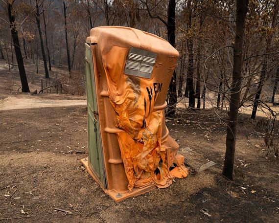 Gideon Mendel: Burnt Portable Toilet, 2020