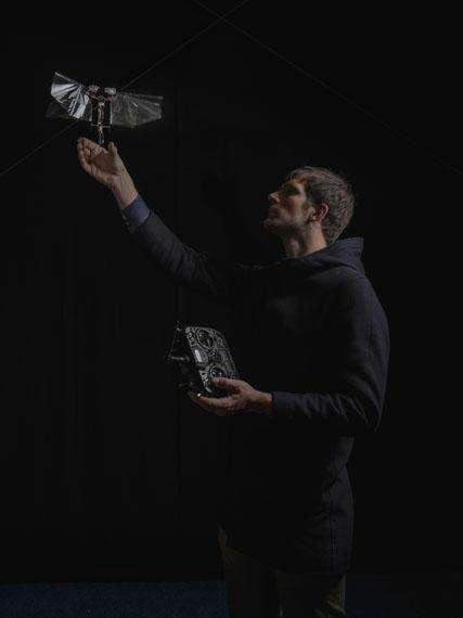 Claudius SchulzeWD2350-RP0469.18Research engineer Matěj Karásek Ph.D. with an autonomous bionic dronePigment print, 2018© Claudius Schulze, Courtesy the Artist / Galerie Robert Morat