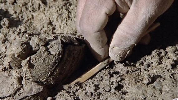 Archaeological excavation at Le Mormont, Video Still: Le crépuscule des Celtes by Stéphane Goël Climage, 2008, Video Still: Archaeology of Sacrifice, 2020 © Stéphane Goël