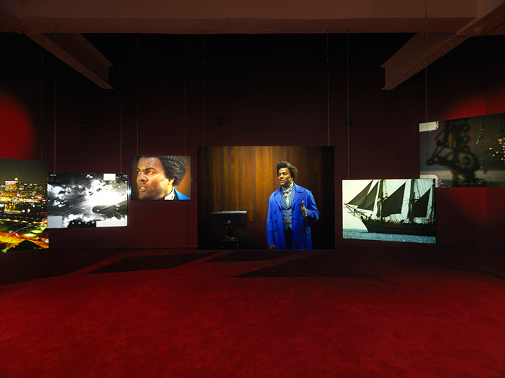 "Isaac Julien, Lessons of the Hour, 2019 (installation view, detail), ten-screen installation, 35mm film and 4k digital, color, 7.1 surround sound. 28'46"". Courtesy of the artist and Metro Pictures, New York"