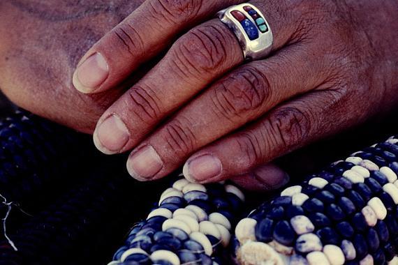 "© Christian von Alvensleben 1977. ""HOPI NATION"", AZ - HANDS OF FERMINA BANYACYA ON INDIAN CORN"