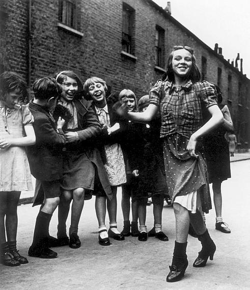 "Bill BrandtEast End Girl Dancing the ""Lambeth Walk"", 1939Private collectionCourtesy Bill Brandt Archive and Edwynn Houk Gallery © Bill Brandt / Bill Brandt Archive Ltd."