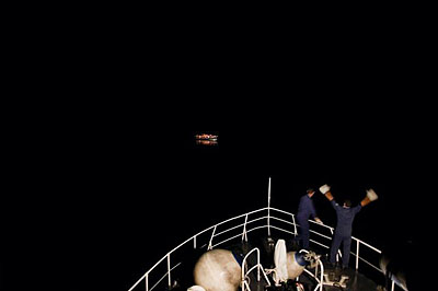 1st prize Contemporary Issues SinglesMashid Mohadjerin, Belgium, ReportersCoastguards spot a boat with refugees, off Lampedusa, Italy, 30 July