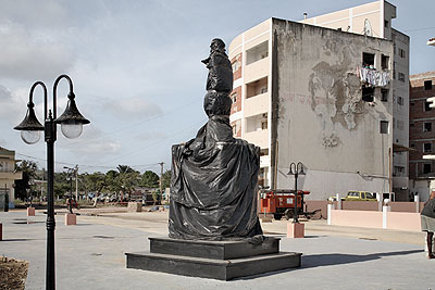Guy TillimNew town square with wrapped statue of Agostinho Neto, Sumba, Angola, 20082008Archival pigment ink on cotton rag paper91.5 x 131.5 cmCourtesy Kuckei + Kuckei