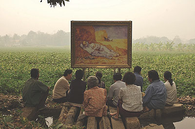Araya Rasdjarmrearnsook Van Gogh's The Midday Sleep 1889/90 and the Thai villagers, 2007 from 'The Two Planets Series' photograph and video 110 x 100 cm; 18 mins Courtesy the artist and 100 Tonson Gallery, Bangkok