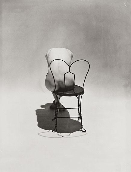 Lot 784Erwin BlumenfeldNude on Coca Cola Chair. 1944Vintage, gelatin silver print, 24,5 x 19,5 cm