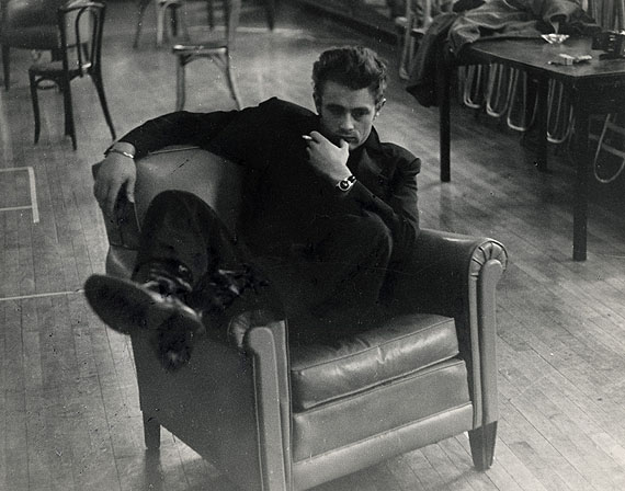 "© Roy Schatt / Courtesy Camera Work, Berlin James Dean in arm chair on the set of ""The Thief"" New York City, 1954"
