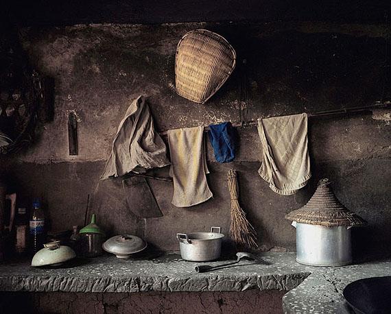 "ROBERT VAN DER HILST: ""Chinese Interiors #11: Kitchen Interior. Haiyan Village on Lake Dianchi, Yunnan Province"" (2006) Archival pigment print. 46cm x 56cm - Ed. of 15; 67cm x 80cm - Ed. of 10; 110cm x 131cm - Ed. of 5. © Robert van der Hilst. Courtesy of m97 Gallery."