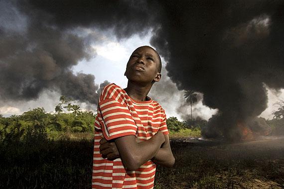 George OsodiOgony Boy. 2007from the Oil Rich Niger Delta seriesC-print© George OsodiCourtesy of Fondazione Cassa di Risparmio di Modena