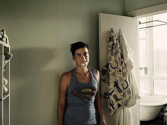 © CHRISTOPHER ANDERSON / MAGNUM PHOTOS. Marion with pacifier at door to bathroom. USA. Brooklyn, NY. 2009.