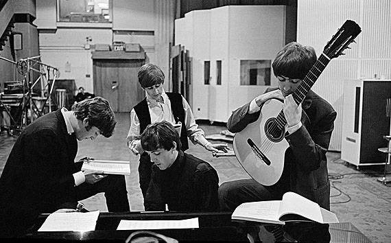 David Hurn - G.B. England. London. The Beatles in the Abbey Road Studios, where many of their most famous records were made, examining the script of the film 'A Hard Days Night'.© David Hurn/Magnum Photos
