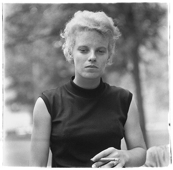 Diane ArbusGirl with a cigar in Washington Square Park, N.Y.C. 1965© The Estate of Diane Arbus