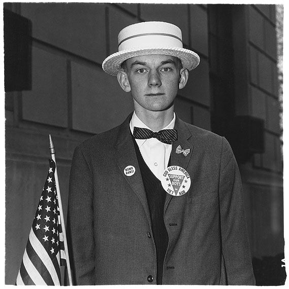 Diane ArbusBoy with a straw hat waiting to march in a pro-war parade, N.Y.C. 1967© The Estate of Diane Arbus