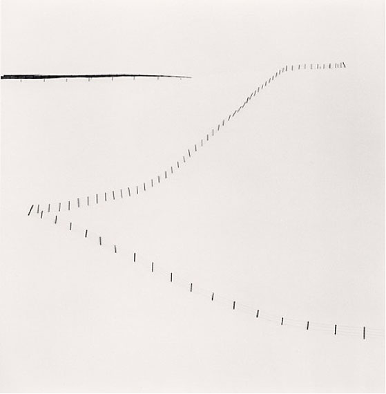 """Hillside FenceSilver gelatin print. 20cm x 20cm - Edition of 45. , Study 6, Teshikaga, Hokkaido, Japan"" (2007)© Michael Kenna. Courtesy of m97 Gallery."