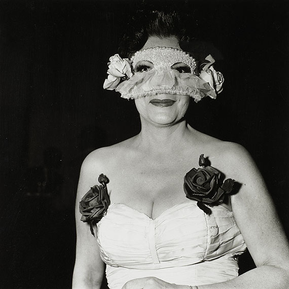 LOT 36Diane ArbusLady at a masked ball with two roses on her dress, N.Y.C., 1967