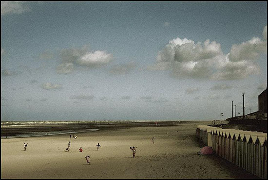 © Harry Gruyaert / Magnum Photos, FRANCE. Picardie region. Bay of the Somme river. Beach of the town of Fort Mahon. 1991.