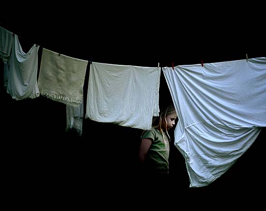 Girl behind laundry, 2003