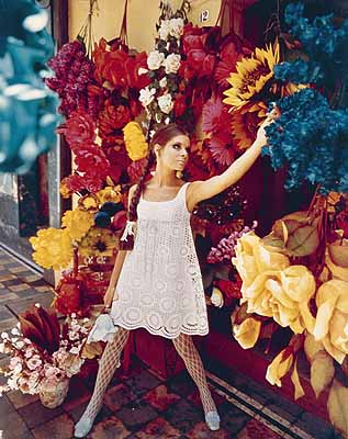Laurence Le Guay (1917–1992)Model in Lacy Dress Posing in front of Flowers c.1960colour photograph; 50.2 x 39.8 cmCollection of Fashion Photographs and PortraitsCourtesy of Candice Le Guay