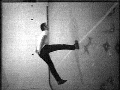 Bruce Nauman, Slow Angle Walk (Beckett Walk), 1968, videotape, black and white, sound 60 min., to be repeated continuously. Distributed by Electronic Arts Intermix (EAI) Courtesy Sperone Westwater, New York.