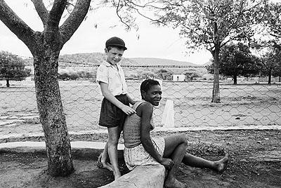 David GoldblattFrom the series «Some Afrikaners Photographed», 1975A farmer's son and his nursemaid, Heimweeberg, Marico Bushveld, Transvaal, 1964Gelatin-silver print, 30,5 x 40,5 cm© David Goldblatt