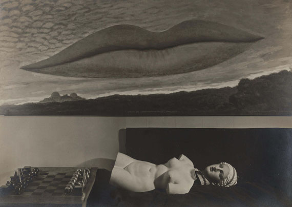 Lot 237MAN RAY (1890-1976)Nature morte avec un jeu d'échecs, moulage en plâtre et A l'Heure de l'Observatoire - Les Amoureux, vers 1935-1936€150,000–200,000