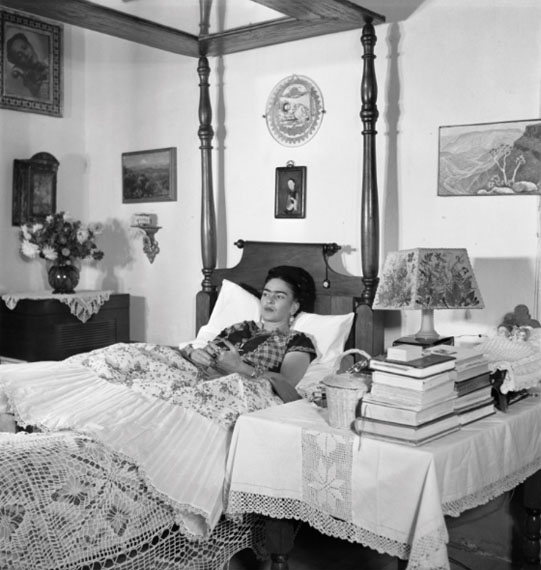 Gisèle Freund: Frida Kahlo lying on her bed, Mexico City, circa 1951Courtesy Collection of Dr. Marita Ruiter, Galerie Clairefontaine Luxembourg © Gisèle Freund/IMEC/Fonds MCC