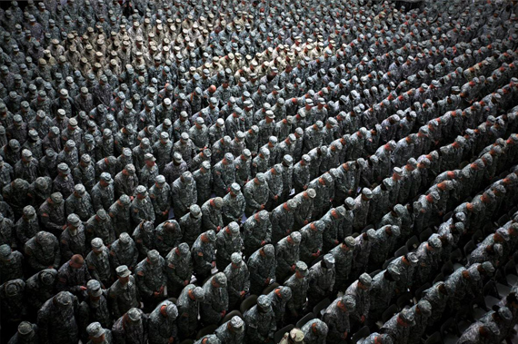 Ashley Gilbertson1,215 American soldiers, airmen, Marines and sailors pray before a pledge of enlistment on July 4, 2008, at a massive re-enlistment ceremony at one of Saddam Hussein's former palaces in Baghdad, Iraq 2008from Whiskey Tango Foxtrot seriestype C photograph69.0 x 94.0 x 5.5 cmCourtesy of the artist© Ashley Gilbertson / VII Network