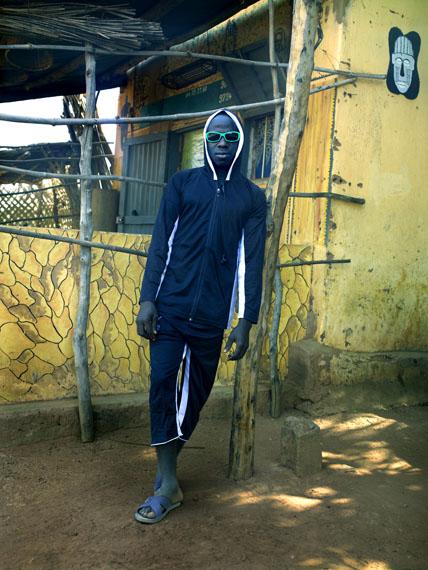 Aboubahkar, outside 'Galerie d'Art Ancien et Moderne,' Tanguieta, Benin, 2011 © Albert Watson