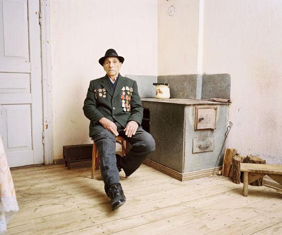© Rob Hornstra. Courtesy Flatland Gallery. Eshera, Abkhazia, 2009 Mikhail Yefremovich Zetunyan (88) has already built his coffin and gravestone. 'I'm waiting to die,' Mikhail says. 'I fought in two world wars. It hasn't got any better.'