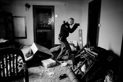 World Press Photo of the Year 2008Anthony Suau, USA, for TimeUS Economy in Crisis: Following eviction, Detective Robert Kole must ensure residents have moved out of their home, Cleveland, Ohio, 26 March