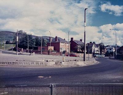Paul Graham, Roundabout, Andersonstown, Belfast, 1984, Vintage chromogenic print, Estimate: £1,200-1,500