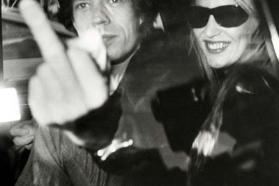 Mick Jagger and Jerry Hall depart Mizuno Gallery en route to L'Ermitage Hotel, January 16, 1983, Beverly Hills, California © Ron Galella.