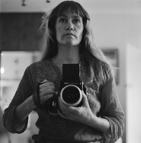 SUE FORD Self-portrait 1974 from the series Self-portrait with camera (1960–2006) selenium toned gelatin silver print, printed 2011 19.9 x 18.0 cm courtesy Sue Ford Archive