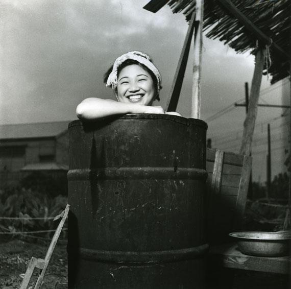 Rikko Nakamura. Taking a bath in a oil drum, Togoshi, Shinagawa‐ku. Modern print. 1946